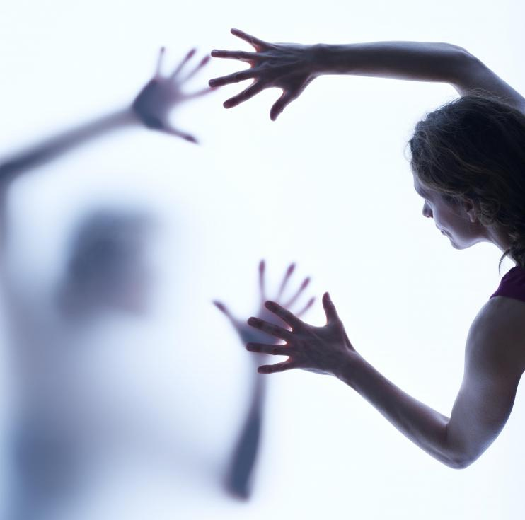 woman-reaching-out-for-another-against-white-background